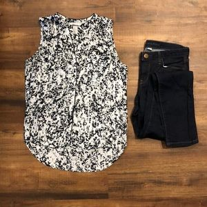 Black and grey sleeveless button up top